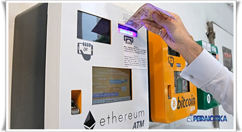 A man uses the Ethereum ATM in Hong Kong, Friday, May 11, 2018. Ethereum is one of the world's popular virtual currency. (AP Photo/Kin Cheung)